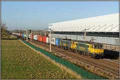 Wrong way round! (Jason 87030) Tags: cans al6 class86 green yellow power scrawl mess awful dreadful design ac electruc freightliner barbynortoft traction locos pair brace lineside ts eddiestobart containers cargo frecht freight 86609 86622
