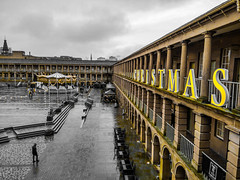 Photoshop Express yellow only effect (Chris Hester) Tags: 478p5 halifax piece hall christmas rain merry go round carousel yellow only photoshop express