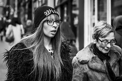 Be Witched (Leanne Boulton) Tags: urban street candid portrait portraiture streetphotography candidstreetphotography candidportrait streetportrait streetlife groupshot woman women female girl face eyes expression mood feeling emotion beanie witch slogan fur furry hair style fashion glasses tone texture detail depthoffield bokeh naturallight outdoor light shade city scene human life living humanity society culture lifestyle people canon canon5dmkiii 70mm ef2470mmf28liiusm black white blackwhite bw mono blackandwhite monochrome glasgow scotland uk