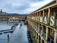Photoshop Express gleam effect (Chris Hester) Tags: 478p4 halifax piece hall christmas rain merry go round carousel gleam photoshop express