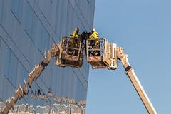 No cherries here. (Philip Brookes) Tags: mannisland liverpool merseyside building reflection cherrypicker crane