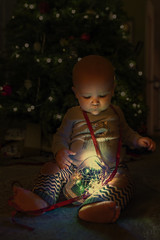 Archie's first Xmas (lgflickr1) Tags: firstchristmas christmas xmas tree lights lowlight cute baby holiday a9 candid face friendly highiso indoors jar kid light sony select curious red ribbon blue ony glow festive