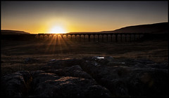 Ribblehead sundown (Blaydon52C) Tags: sunset sun winter yorkshire chirk viaduct limestone carlisle dales settle ribblehead colas 70809 railfreight 6j37 shadow orange sunlight history silhouette yellow stone dark evening scenic