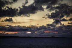 Molokai sunset (cheezepleaze) Tags: sunset molokai hawaii lighthouse clouds sea cliche island pacific usa
