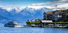 Lake Como - Villa Melzi (Bobinstow2010) Tags: lakecomo water lake blue mountains italy boat landing snow hotels buildings sky clouds