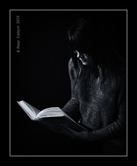 A Good Book (Peter Camyre) Tags: female model haleigh read reads book black white monochrome sweater glasses dar peter camyre photography photogrpher picture portrait reading librarian office girl lady