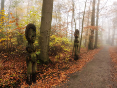 The guardians of the forest (Zoom58.9) Tags: forest trees leaves autumn skulptur wood way nature park europe germany bremerhaven wald bäume blätter herbst holz weg natur europa deutschland sony sonydscrx10m4