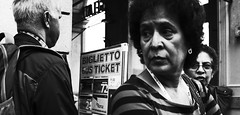 That's the ticket. (Baz 120) Tags: candid candidstreet candidportrait city contrast street streetphoto streetcandid streetportrait strangers rome roma ricohgrii europe women monochrome monotone mono noiretblanc bw blackandwhite urban life portrait people provoke italy italia girl grittystreetphotography faces decisivemoment