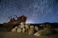 Out for a Spin (bluegreenorange) Tags: california nightphotography artinstallation art galletameadows astrophotography nightsky ricardobreceda startrails roadside borregosprings jeep night