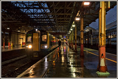 Dusk impressions (david.hayes77) Tags: siemens desiro crewe cheshire 2019 autumn dusk bluehour class350 350111 lnwr londonnorthwesternrailway 1u38 reflections rain downpour sony dscrx100m3 emu atmosphere crew driver impression architecture victorian victoriana shower