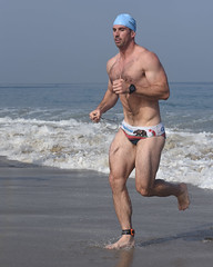 Muscular Swimmer in California Swimsuit (Chris Hunkeler) Tags: man muscular beefy hairy athletic male athlete swimmer running swimsuit swimbrief speedostyle california built