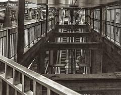 Subway Interior passageway - Reflections and Shadows (nrhodesphotos(the_eye_of_the_moment)) Tags: dsc009523001084 wwwflickrcomphotostheeyeofthemoment theyeofthemoment21gmailcom monochrome blackandwhite nyc mta reflections shadows geometric escalator people metal rail gates columns subway underground lines passengers