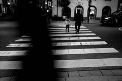 A black shape (stefankamert) Tags: street crossing black shape monochrome motionblur lines stefankamert 28mm wideangle people noir noiretblanc blackandwhite blackwhite bw rottweil dark mysterious ricoh gr griii