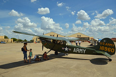The shade of the wing (radargeek) Tags: airshow henrypostarmyairfield fortsill september 2018 ok oklahoma clouds sky kid kids child children plane