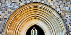 Semi circles galore (Rapid Spin) Tags: architecture arch portal church building stone wall