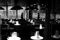 Before the diner (pascalcolin1) Tags: paris13 femme woman diner tables fenetres windows lumière light ombres shades reflets reflection glace miroir mirror photoderue streetview urbanarte noiretblanc blackandwhite photopascalcolin 5omm canon50mm canon