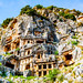 Lycian city of the dead carved into the hillside of Myra in Southern Turkey, complete with startlingly human touches.