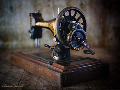 A Stitch in Time (manxmaid2000) Tags: old vintage singer sewing machine wood handle wheel wooden sew crank antique steel lockstitch stitch needle manual gold lettering black dark craft hobby worn