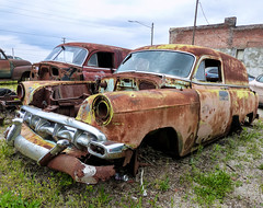 Two Rusty Chevrolet Sedan Delivery Panel Vans (J Wells S) Tags: chevroletsedandeliverypanelvans chevy gm generalmotors rust rusty crusty junk abandoned chrome route66 galena kansas themotherroad