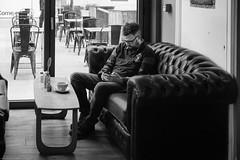 Checking messages (gwpics) Tags: indoors man england greatbritain mobilephone streetphotography southampton people uk mono britain editorial everydaylife hampshire hants lifestyle male men monochrome person society unitedkingdom blackandwhite cellphone street streetlife