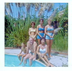 People Posing Poolside, 1960s (StevenM_61) Tags: women man boy people bathingsuits swimsuits swimmingpool 1960s foundphotograph