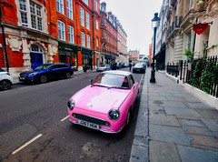 Pink Car in London, England (` Toshio ') Tags: toshio london england unitedkingdom greatbritain car automobile pink street road city europe fujixt2 xt2