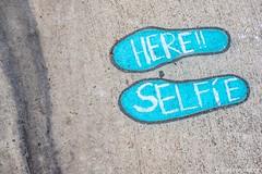Selfie Here (www.karltonhuberphotography.com) Tags: 2019 california citystreets humorous karltonhuber lookingdown santaana streetphotography urban