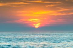 Rocky Smoke Haze Sunrise Seascape (Merrillie) Tags: horizon nature dawn newsouthwales sea haze morning ocean coastal sky hazy northavoca northavocabeach overcast clouds coast australia rocks earlymorning sun landscape outdoors avocabeach nsw water bushfiresmoke rocky waves sunrise seascape smoky centralcoast smokehaze waterscape