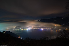 Foggy night in Como... (Lorenzo Banfi) Tags: como notturna brunate night shot fog nebbia cloud nuvole clouds lago lake lario ponte chiasso svizzera italia italy switzerland lipomo battello porto stadio luci soffuse notte buio faro voltiano piazza strada auto navi idrovolanti idropista aereo moon luna montagne rock mountains