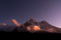 Evening Light on Ama Dablam (Ian Hearn Photography) Tags: cloud clouds catch golden light lighting they roll front mount ama dablam 22 000ftfeetfootmountaininthe himalayas 20000 22349 20234 6170 meters blue hour ian hearn wwwianhearncom nepal eastern np solukhumbu solukhumba rule thirds purple black white snow peaks peak south face west western faces sun set sunset sagarmatha national park nature natur landscapes scenic scenery scene mountain mountains magic hours himal himalayan hill alpine habitat rocks rock formations mass natural mothers necklace pendant dhusum
