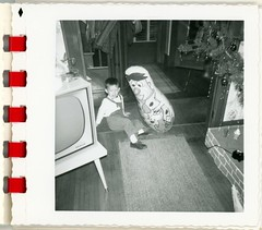 A Boy Playing with His Fred Flintstone Punching Bag (Alan Mays) Tags: ephemera photographs photos foundphotos snapshots portraits christmas xmas december25 holidays christmastrees ornaments decorations interiors rooms flintstones televisionshows television tvshows tv shows sitcoms cartoons animated tvs televisionsets tvsets rcavictor fredflintstone puncho punchingbags bopbags dolls toys playing children boys clothes clothing crying wallpapers superpaksnaps 1960s antique old vintage vptp