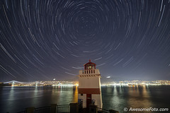 Startrails with Lighthouse (james c. (vancouver bc)) Tags: park startrails night sky lights abstract arcs astronomic astronomy celestial circle harmony motion polaris rotation serenity space star starry trace trail tranquil universe north vancouver canada lighttrail atmosphere scenery starlight dark outdoors infinite background nature constellation stellar outerspace astro brocktonpointlighthouse britishcolumbia stanleypark burrardinlet reflection mountain water sea lionsgatebridge bridge