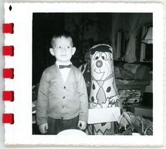 A Boy and His Fred Flintstone Punching Bag (Alan Mays) Tags: ephemera photographs photos foundphotos snapshots portraits christmas xmas december25 holidays interiors rooms flintstones televisionshows television tvshows tv shows sitcoms cartoons animated rca fredflintstone puncho punchingbags bopbags dolls toys children boys clothes clothing ties bowties sweaters facialexpressions expressions faces superpaksnaps 1960s antique old vintage vptp