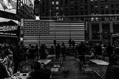 They've all come to look for America (Bryan Appleyard) Tags: times square nyc flag stars stripes monochrome blackandwhite tables america americano