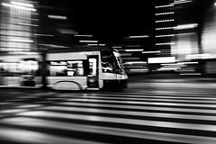 Speed of light (maciej_urbanowicz) Tags: d750 nikon streetphoto streetphotography warsaw warszawa night nightphoto streets uwa wide wideangle masovianvoivodeship poland light monochrome blackwhite bw tram street city lights dark movement speed panning photography
