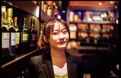 The cigar shop waitress (waex99) Tags: 2019 400vc 50f2 kodak leica m6 oct singapore m4 portra summitar vintage rangefinder 50mm woman aian femme asiatique chinatown shopkeeper cigar shop lowlight color macallan interior bokeh