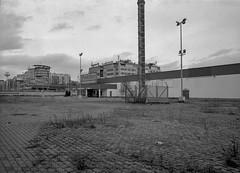 Katowice, Poland. (wojszyca) Tags: fuji gsw680iii 6x8 120 mediumformat fujinon sw 65mm bergger pancro 400 hc110 epson v800 city urban urbanlandscape decomissioned vacant abandoned parking lot supermarket katowice