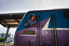 A train commander (Cadicxv8) Tags: train transportation railroad rail vietnam saigon people driver rider ride