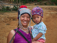 Akha tribe members (Alejandro Hernández Valbuena) Tags: hillthailandtribe silverjewelry ethnicgroup akha asia jewelry northern thailand women burma costume fun hat hill indigenous minority refugee teeth tolerated traditionally tribe son