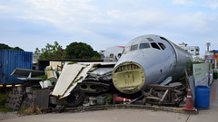 McDonnell Douglas MD-81 c/n 53298 Orient Thai Airlines registration HS-MDI stored dismantled at a Transport Company Yard in Bangkok (Erwin's photo's) Tags: mcdonnell douglas md81 cn 53298 orient thai airlines registration hsmdi stored dismantled transport company yard bangkok wrecks relics w r wr aircraft aviation thailand airliner