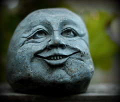 Beware of the teeth.... (SquireRoss) Tags: yardart stonehead faces blue humorous