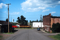 A South Shore Town (view2share) Tags: wc3012 august291995 gp40 emd electromotivedivision engine eastbound duluthsouthshoreatlantic dssa wisconsin wi wc wisconsincentral northernwisconsin northwoods northwood caboose remotecontrol saxon whitepinesub town hamlet railway railroading rr railroads rail railroad rails railroaders rring roadtrip rural rrcar ironcounty smalltown august1995 august 1995 track transportation trains tracks transport trackage trees train travel freightcar freighttrain freight freightcars deansauvola farm farming dairy summer building ghosttown brick street highway horizon sky clouds