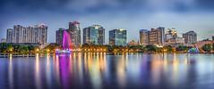 Orlando Skyline (Joe Rebello) Tags: orlando skyline lakeeolapark longexposure fountain dusk evening downtown florida starburst diffractionspike urban cityscape trees skyscrapers modern unitedstatesofamerica