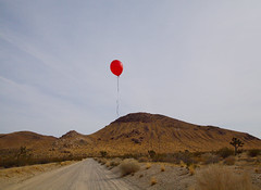 I tied it to your wrist (Maureen Bond) Tags: ca desert maureenbond balloon red mountain hill road dirt string clouds privateproperty itiedittoyourwrist gotaway flying floating lost gone