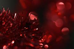 Tinsel (Dreaming of the Sea) Tags: 2019 bokeh red macromondays nikond7200 tamronsp90mmf2811macro dof depthoffield reflections stars glitter hbw bokehwednesday