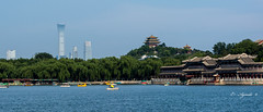 Modern and Old (E. Aguedo) Tags: beihaipark beijing asia skyline sky qianhailake architecture old modern ngc travel tourism
