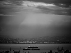 Storm clouds over the East Bay (kate beale) Tags: sanfrancisco sanfranciscobay shipping portofoakland eastbayhills blackandwhite sanfranciscoblackandwhite clouds stormclouds