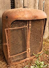 Displaced Radiator (lorinleecary) Tags: barnwood lines rust radiator machinery curves