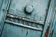 Tu Ne M'Ecris Plus (Katrina Wright) Tags: france nîmes provence dsc7309edit hss sliderssunday door angle line texture pattern weathered peelingpaint damage old vintage blue grey doorknob letters lettres