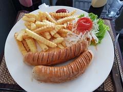 Bratwurst and Fries at The Good Corner (SierraSunrise) Tags: thailand phonphisai nongkhai isaan esarn restaurant german food sausage wurst bratwurst frenchfries salad tomato